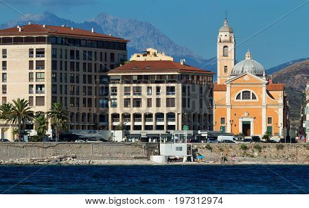 Ajaccio cityscape with blue sea on the island Corsica, France with mountains on the background.