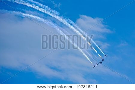 Aerobatic team making loopings in the air sky