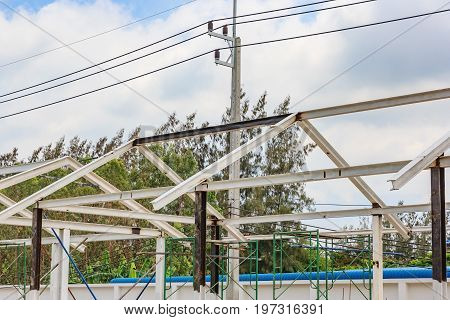 steel and iron roof structure of under construction site building