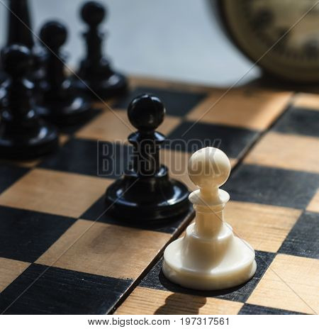 White and black pieces on chess board