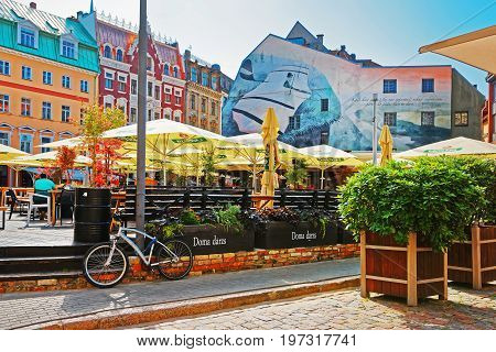 Street With Cafe And People In Historical Center Riga Baltic
