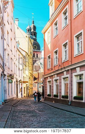 Riga Cathedral In Street In Old Town Of Riga Baltic