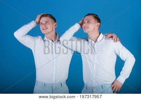Happy Men Hugging And Touching Hair