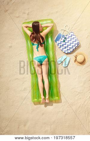 Young female traveler tourist top view sunbathing sleeping