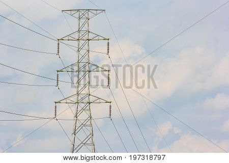high voltage post. High-voltage tower in blue sky background.