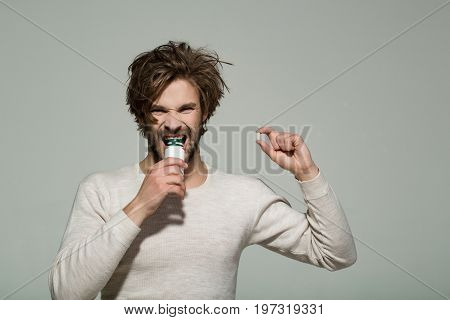Health and medicine. Guy hold dieting pill and vitamin. Treatment and hypnotic tablet. Man with pill in plastic jar. Drug and antidepressant.