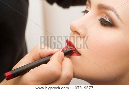 Girl Getting Red Lipstick Crayon On Lips