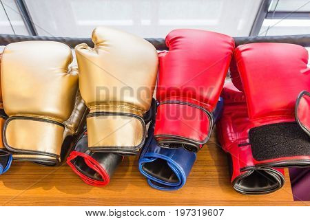 Stack of leather boxing gloves on a wooden table