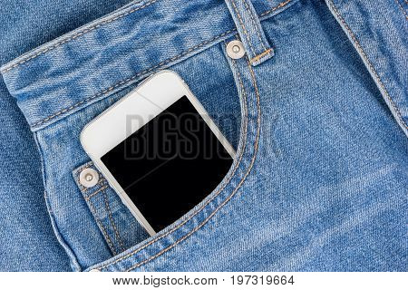 Smartphone with black screen with empty space for text in a jeans pocket