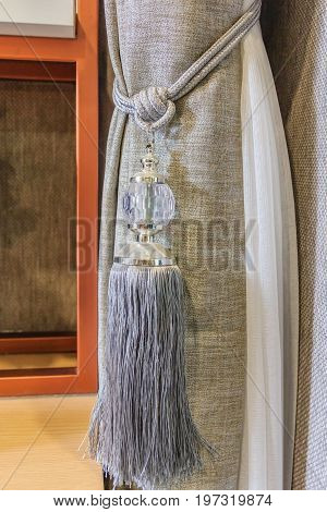 beautiful Curtains tassel by curtain strap with sunlight for interior luxury house Selective focus
