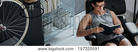 Man Reading In His Room