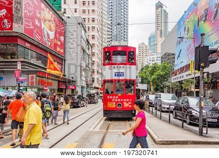 HONG KONG, CHINA - JULY 21, 2013: Unidentified people using city tram in Hong Kong on July 21, 2013. Hong Kong tram is the only in the world run with double deckers and one of the main tourist attractions.