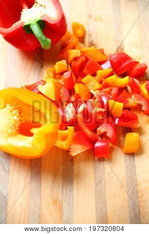 Cutting board with red and yellow peppers with room for text