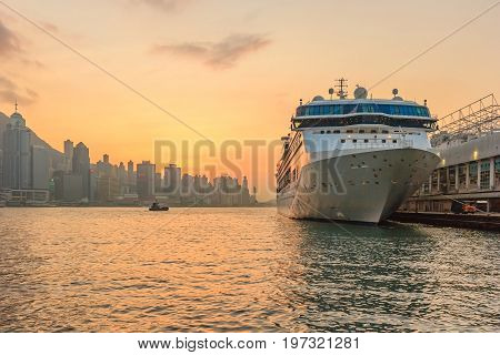 The Star Ferry is a passenger ferry service operator in Hong Kong which transports passengers across Victoria Harbour on its sail boats. Ferry boat mooring at victoria Harbour in Hong Kong at sunset