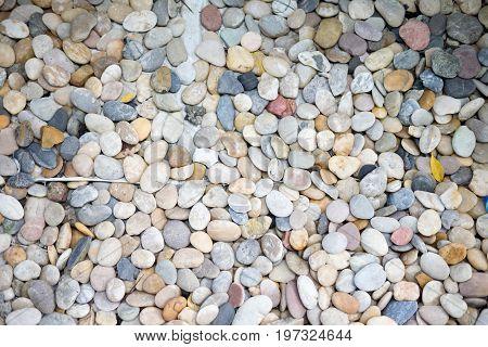 Pebble stones texture pebble background, top view