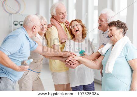 Elders Laughing Before Yoga Classes