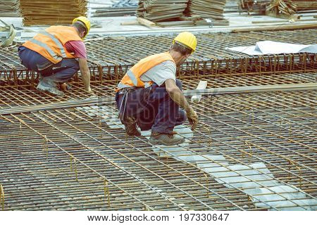 Ironworker Workers Working On Concrete Reinforcements 4