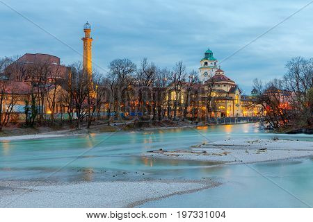 View of the city embankment and the river Isar at sunset. Munich. Germany. Bavaria.