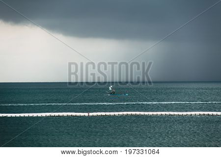Dark Sky Cloud Rain Strom In The Sea In Rainy Season With Alone Fishing Boat.