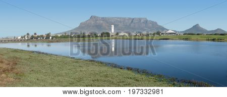 FROM CAPE TOWN, SOUTH AFRICA, MILNERTON LAGOON, WITH THE SHADOW OF TABLE MOUNTAIN ON THE WATER 36zc