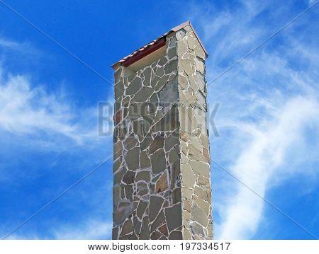 brick smokestack isolated on background of blue sky