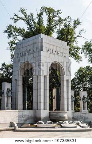 WASHINGTON, DC - JULY 12, 2017:  The Atlantic triumphal arch, with fountain and wreaths at the World War II Memorial on the National Mall, dedicated to the Americans who served during World War II.