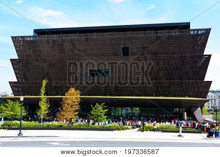 WASHINGTON, DC - JULY 12, 2017:  Crowds of people lined up outside of the National Museum of African American History and Culture, a Smithsonian Institution museum, located on the National Mall.