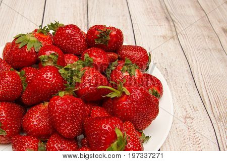 Bright strawberry closup background at wooden background