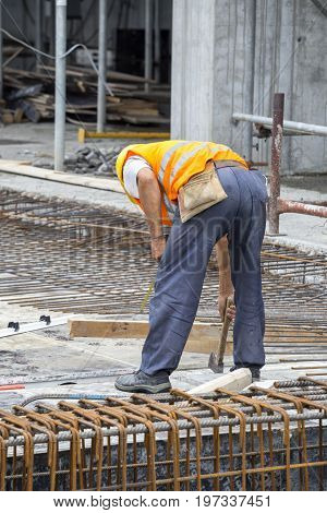 Reinforcing Ironworker Working On Concrete Formwork
