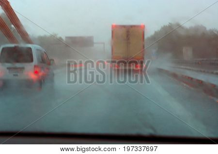 Danger of a traffic jam in heavy rain. Severe weather on the highway and bad driving conditions.