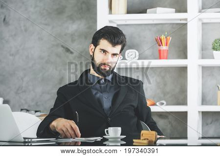 Bored Businessman At Workplace