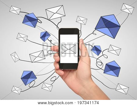 Hand holding smartphone with e-mail network on gray background. Email networking concept. 3D Rendering