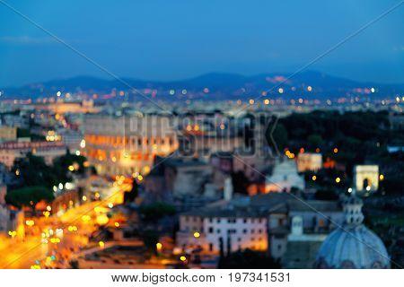 Via Dei Fori Imperiali And Colosseum In Rome At Night