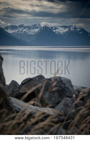 Rocky Shoreline And Mountains