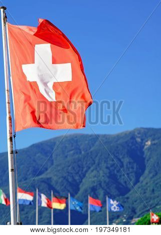 Flags In Ascona Ticino Switzerland Alps On Background