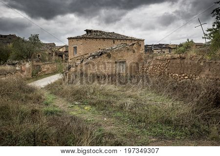 ruins of abandoned rustic houses made of wood and clay in Navapalos, Soria, Spain