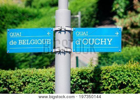 Quai Ouchy and Quai de Belgique Street indicator in Lausanne Switzerland.