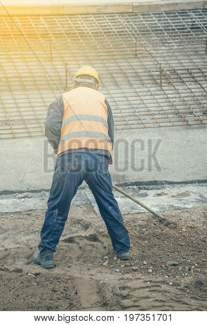 Worker With Rake Working