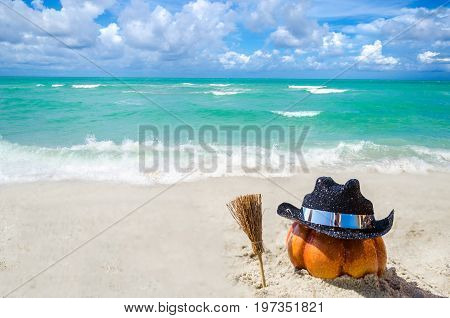 Halloween pumpkin background on the sandy beach near the ocean