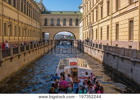 Saint Petersburg, Russia - June 17, 2017: Tourist boat moves along the Winter Canal near the Hermitage. It is a popular trip in the city