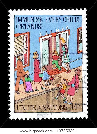 UNITED NATIONS - CIRCA 1987 : Cancelled postage stamp printed by United Nations, that promotes Immunizing children.
