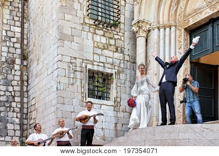 Bride And Groom And Musicians In Church In Dubrovnik