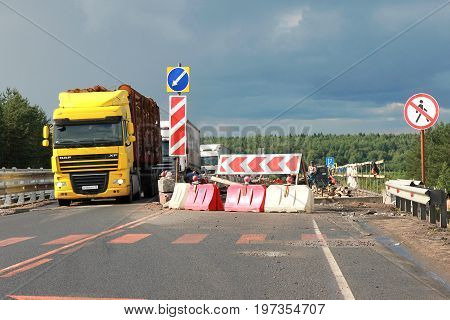 Lodeynoje Pole, Russia - July 22TH, 2017: Road repairs, one-way traffic, heavy vehicles are slowly driving along the highway