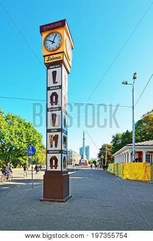 Square With People And Clock In Old Town Riga Baltic