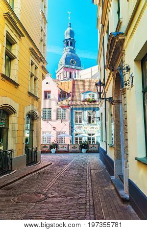 Riga Cathedral In Street At Old Town Of Riga Baltic