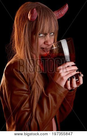 Girl in the guise of the devil is drinking red blood