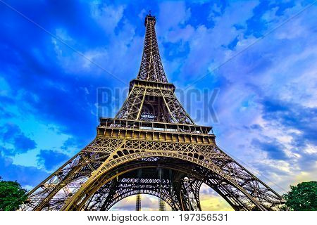 Paris, France, Eiffel Tower, illuminated at sunset The Eiffel Tower was built in 1889, and is a popular attraction for tourists.