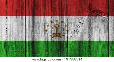 Tajikistan Flag Painted On Wooden Wall For Background