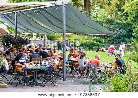 People At Open Air Cafe In Bern Swiss