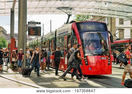 Passengers And Tram At Railway Station Bahnhofplatz Bern Swiss